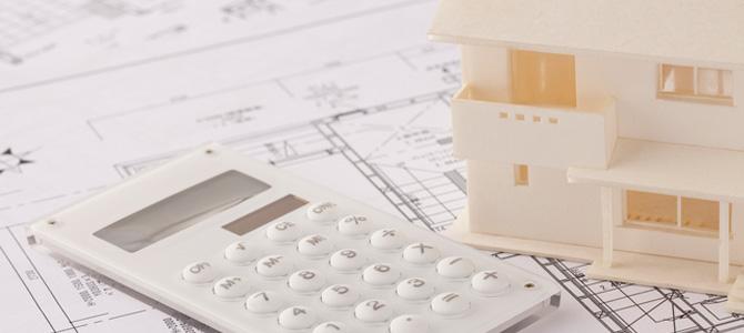 電卓と設計図と家